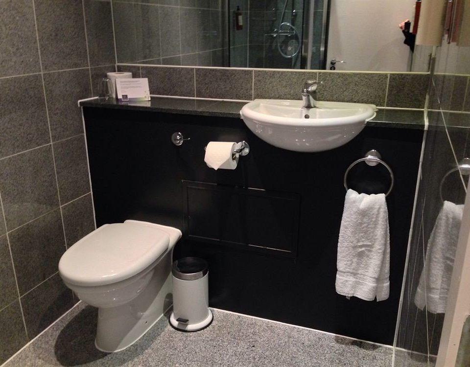bathroom toilet sink plumbing fixture bidet tile rack tiled