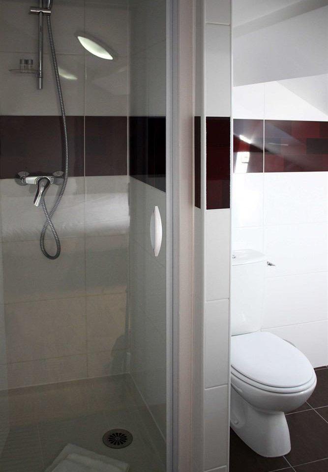 bathroom toilet plumbing fixture shower bidet tiled tile