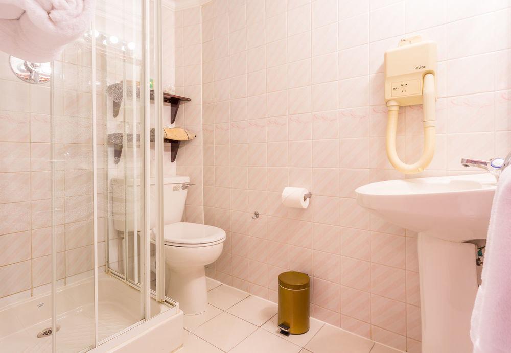 bathroom plumbing fixture sink toilet bidet tile tiled
