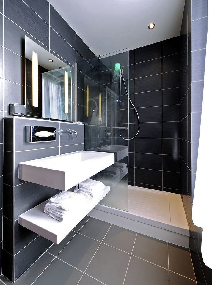 bathroom black flooring tile plumbing fixture computer
