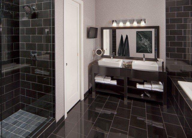bathroom property flooring tile black white home plumbing fixture toilet tiled