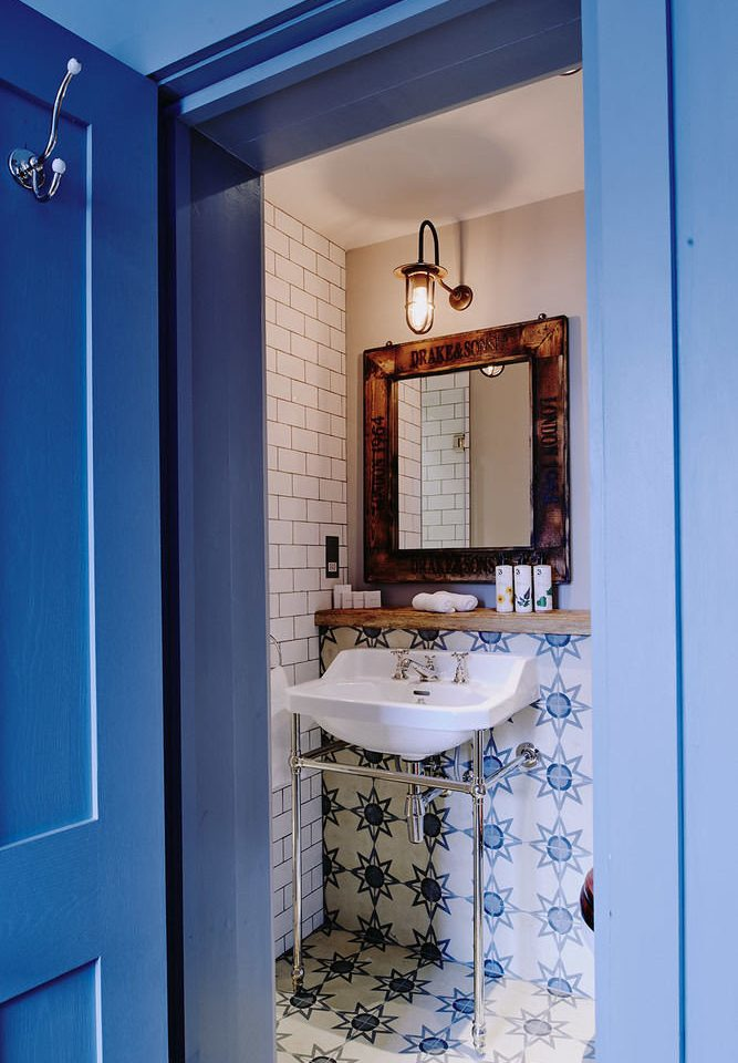 bathroom blue house home toilet white plumbing fixture door painted