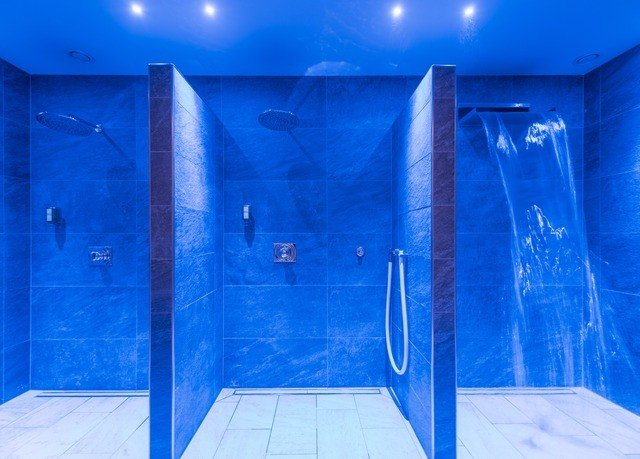 blue swimming pool structure plumbing fixture glass public toilet tile tiled bathroom