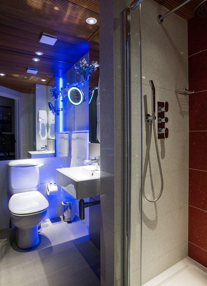 bathroom blue toilet plumbing fixture home public toilet tile tiled