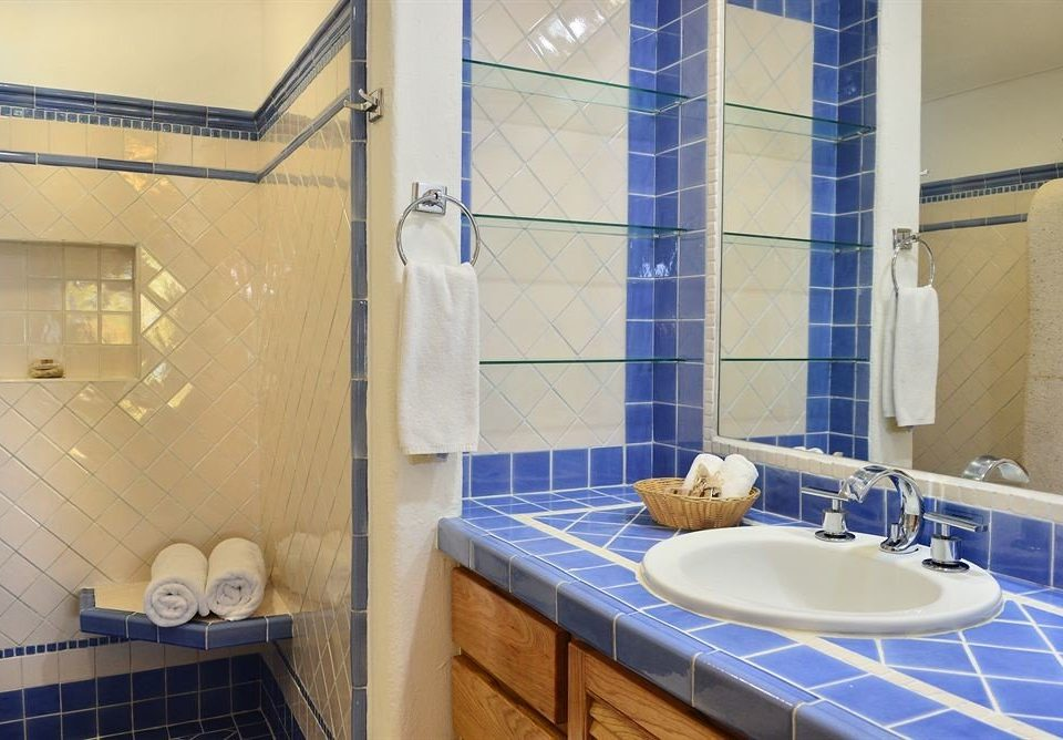 bathroom property sink blue swimming pool toilet home tile towel tiled tub