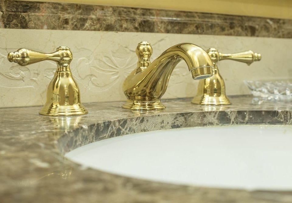 bathroom sink counter plumbing fixture brass tap metal material