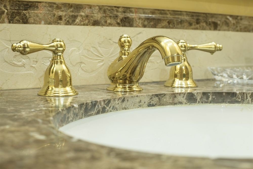 bathroom sink counter plumbing fixture brass tap metal material