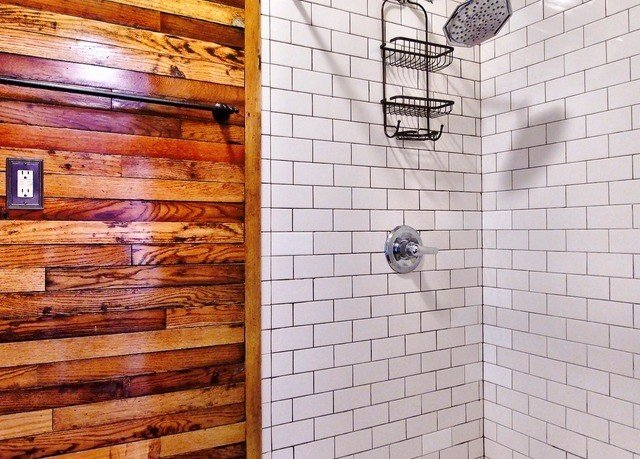 man made object brickwork brick flooring tile bathroom tiled dirty
