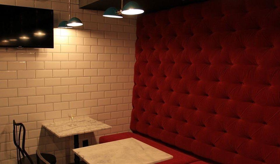 red flooring brick lighting tile tiled bathroom