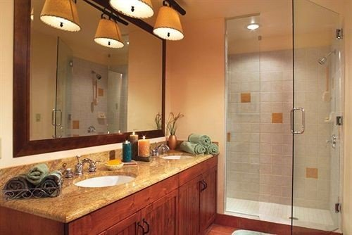cabinet bathroom property sink hardwood cabinetry cottage plumbing fixture tan