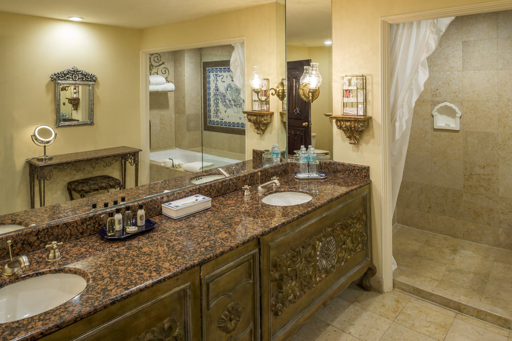 bathroom sink property counter home cabinetry countertop flooring plumbing fixture mansion cottage vanity tile tiled