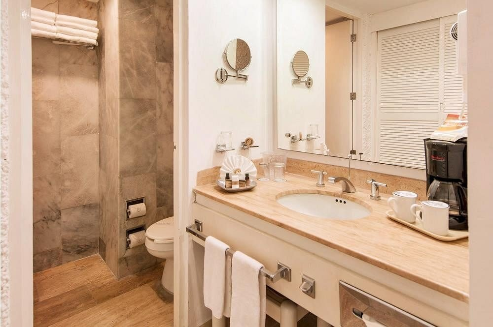 bathroom property sink white home cuisine classique cabinetry cottage flooring plumbing fixture tan