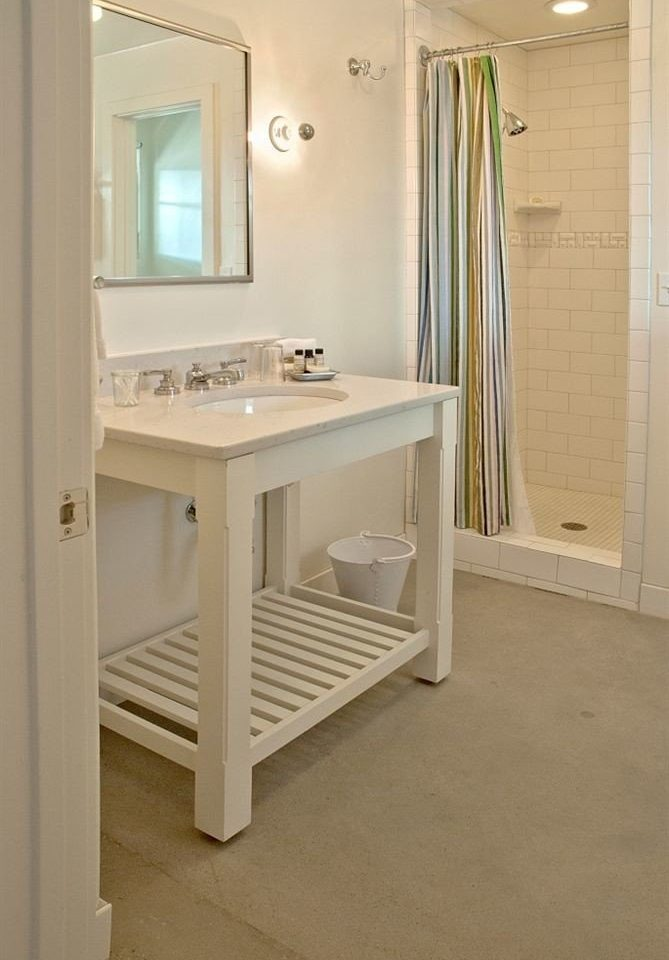 bathroom property house home flooring white plumbing fixture cabinetry cottage