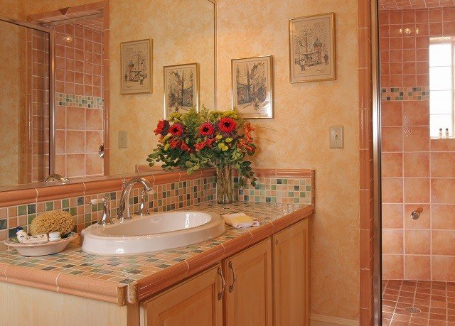 bathroom property home cabinetry sink cottage flooring plumbing fixture tan