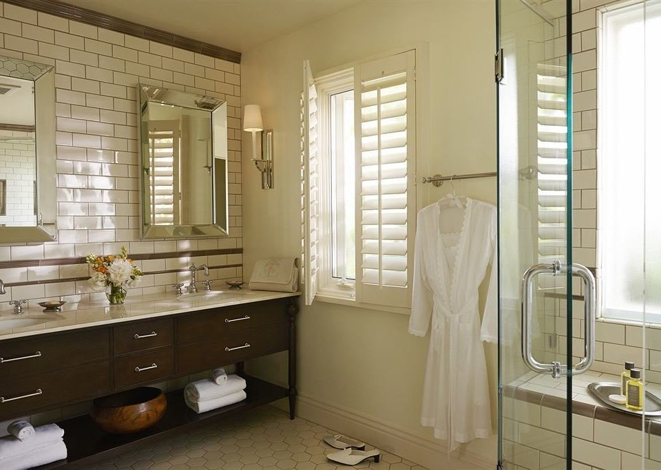 bathroom property sink home cabinetry cottage tub