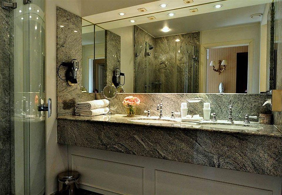 bathroom mirror sink property countertop home counter plumbing fixture cabinetry