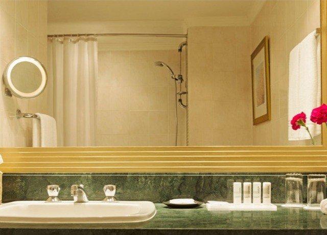 bathroom sink mirror countertop cabinetry plumbing fixture dining table