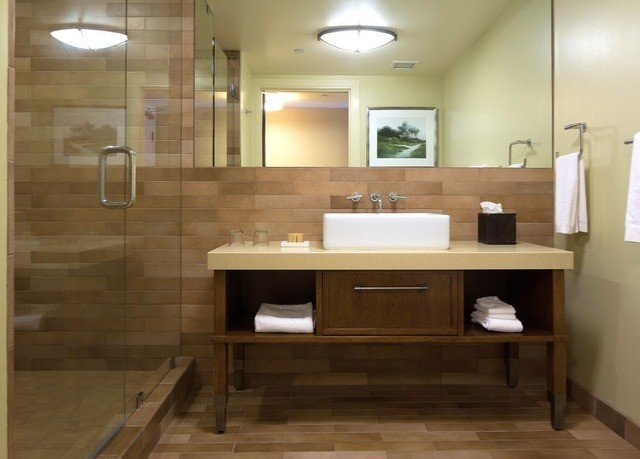 bathroom cabinetry hardwood sink flooring plumbing fixture