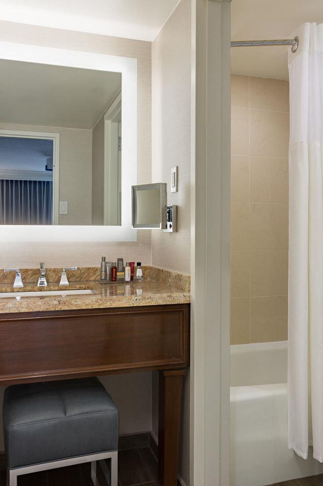 bathroom property cabinetry home hardwood sink flooring plumbing fixture