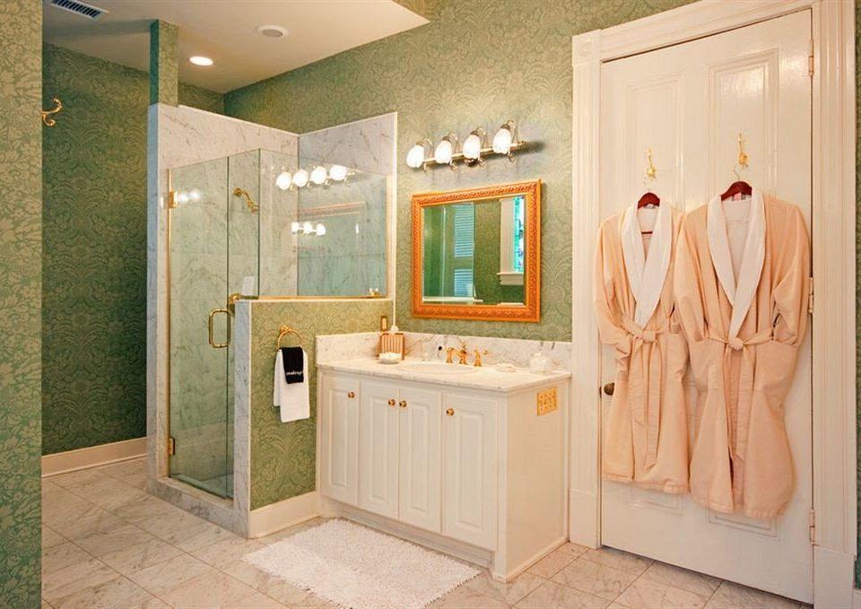 bathroom property home plumbing fixture cabinetry flooring