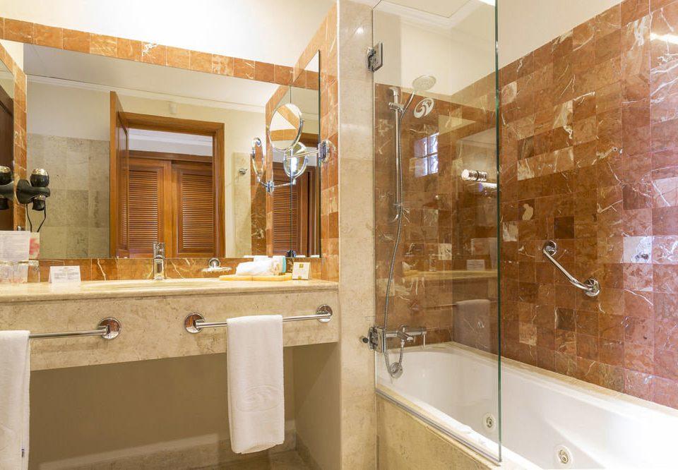bathroom property sink home plumbing fixture cabinetry flooring tile tan
