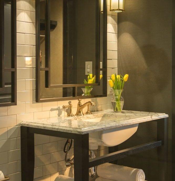bathroom mirror sink cabinetry lighting home plumbing fixture public towel glass toilet