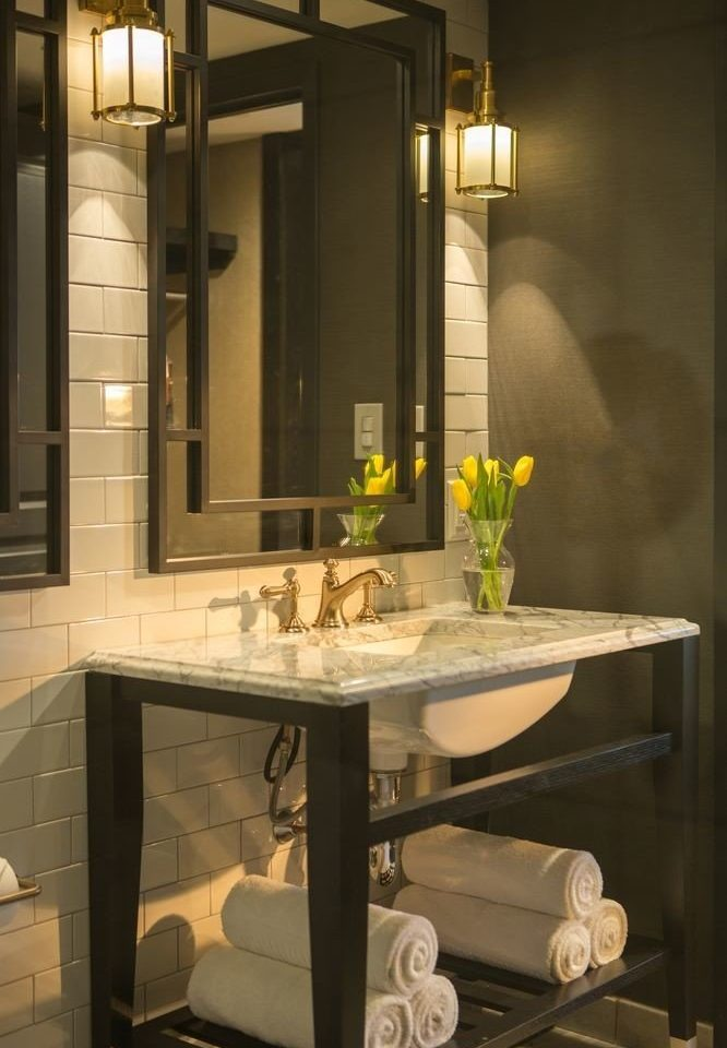 bathroom mirror sink cabinetry lighting home plumbing fixture public towel glass toilet