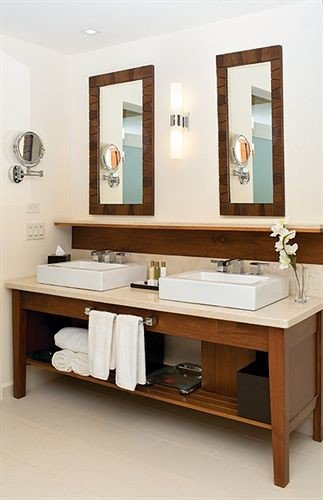 bathroom mirror sink hardwood cabinetry plumbing fixture