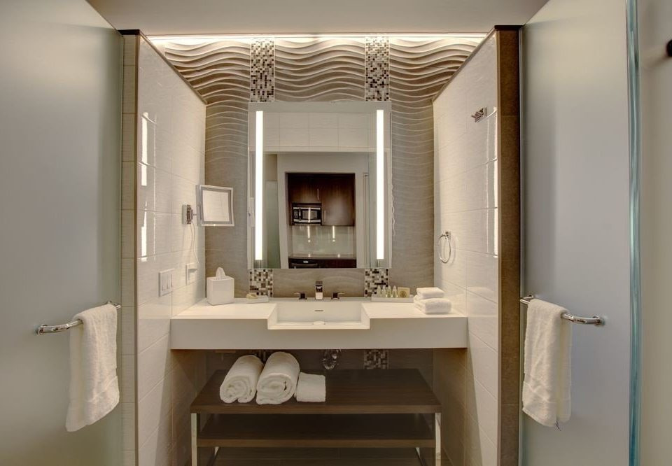 bathroom mirror property sink cabinetry home living room toilet
