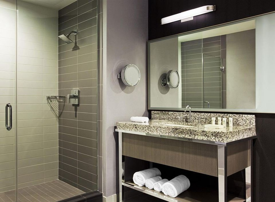 bathroom mirror sink plumbing fixture cabinetry