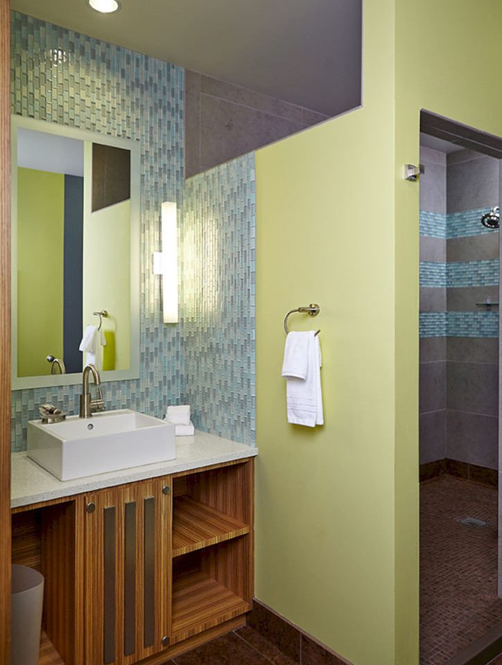 bathroom sink mirror cabinetry plumbing fixture tiled