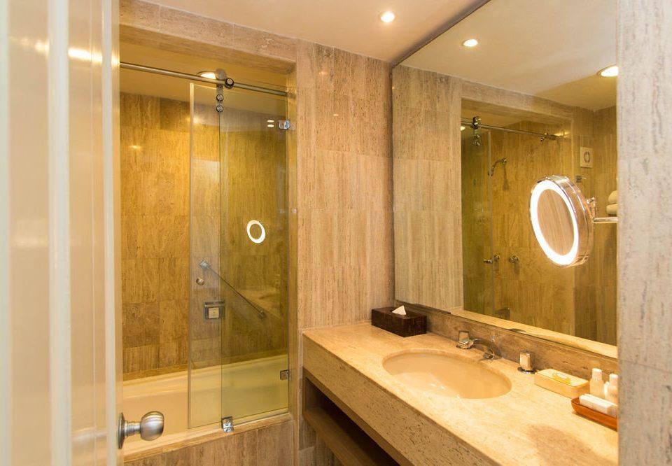 bathroom plumbing fixture sink cabinetry tan