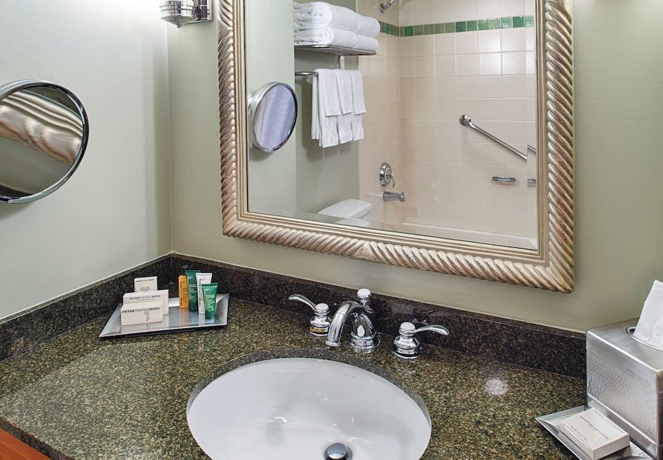 bathroom mirror sink property home countertop flooring cottage plumbing fixture towel toilet clean