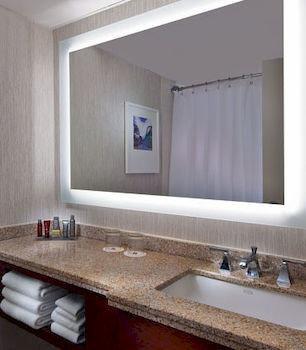 bathroom sink mirror property counter countertop living room plumbing fixture flooring material clean