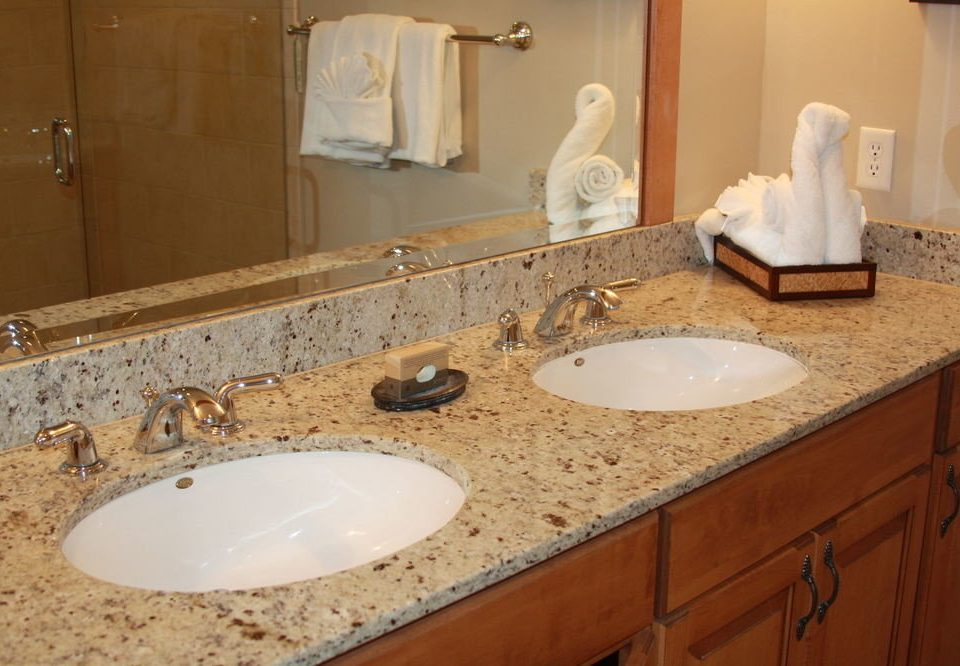 bathroom sink mirror counter property countertop double vanity toilet plumbing fixture flooring material clean tan