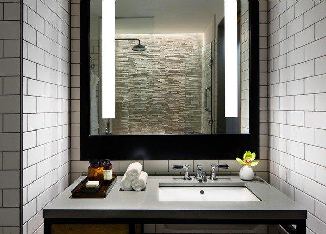 bathroom mirror sink property countertop home tile plumbing fixture flooring counter tiled public clean