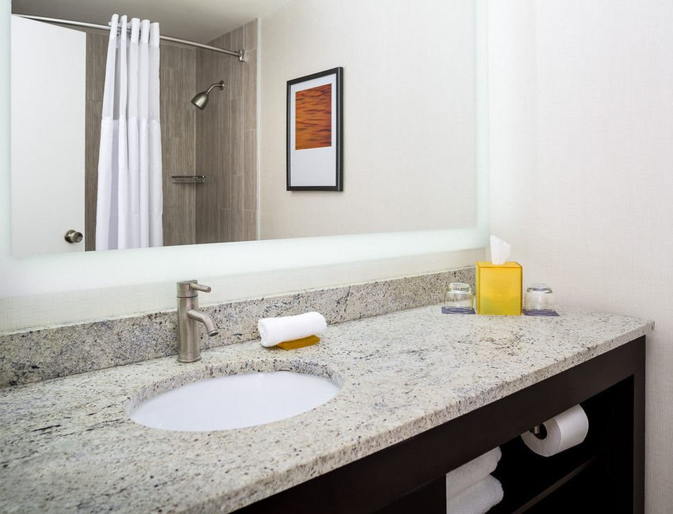 bathroom sink mirror counter property countertop flooring home vanity tile plumbing fixture toilet clean