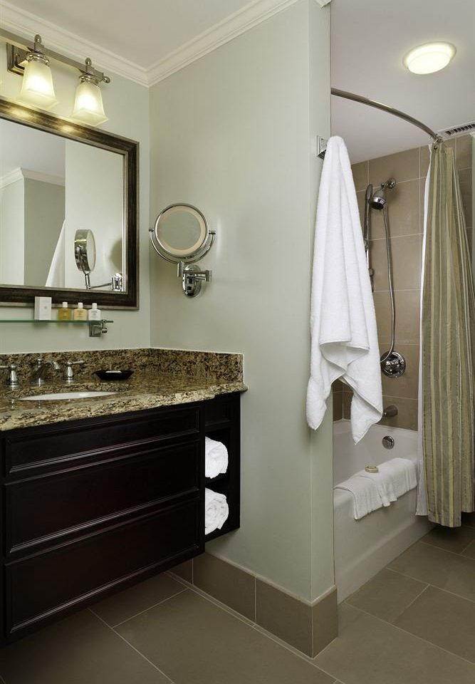 bathroom mirror sink property towel home flooring counter vanity rack plumbing fixture tile clean