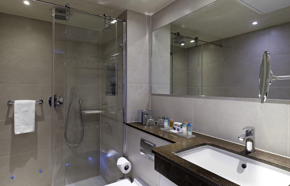 bathroom sink mirror property toilet counter home plumbing fixture clean public