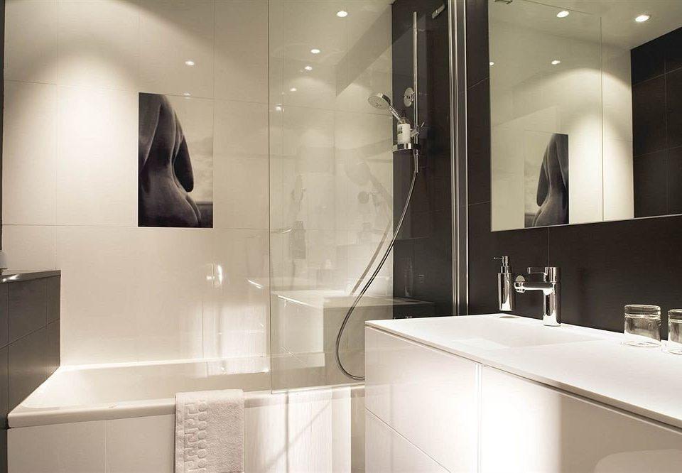 bathroom mirror sink white toilet lighting plumbing fixture clean tile tiled