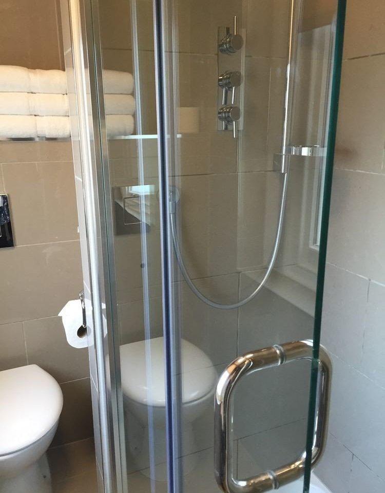 bathroom shower glass scene plumbing fixture stall toilet clear tiled tile