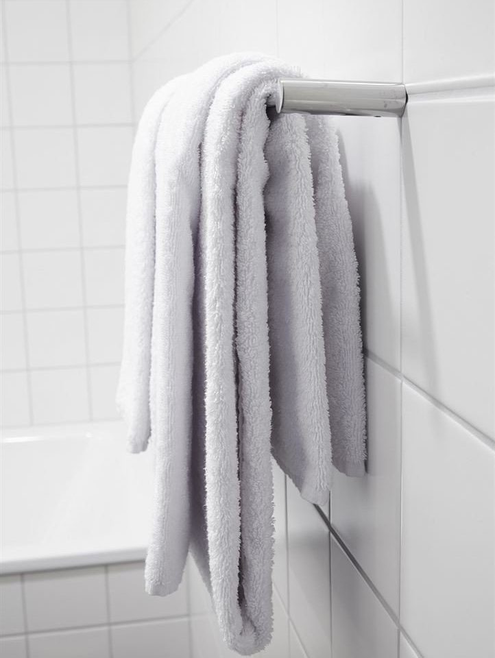 bathroom white clothing towel textile outerwear wool fur material rack tile