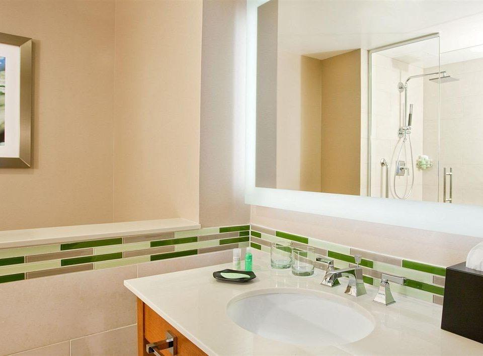 bathroom sink mirror property home counter countertop flooring condominium colored