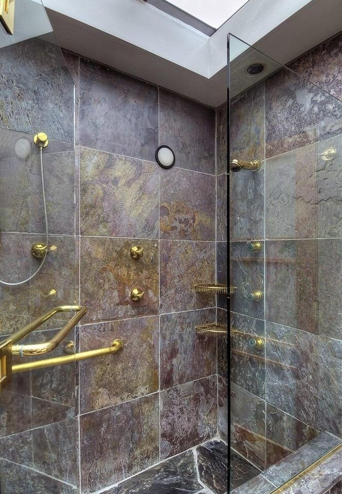 plumbing fixture bathroom flooring tile shower colored tiled dirty
