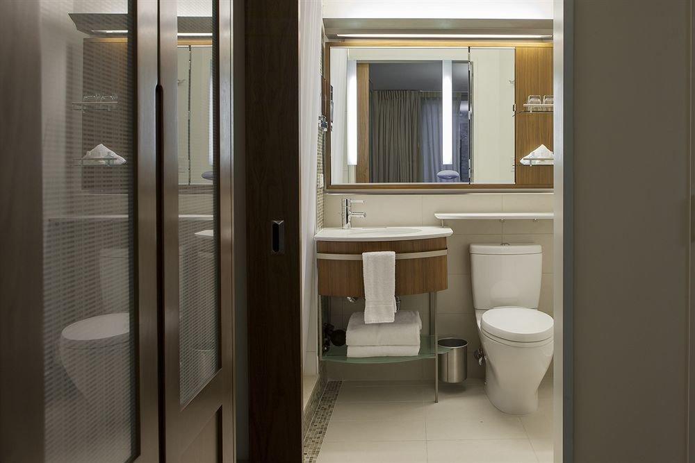 bathroom mirror toilet property sink door home condominium public