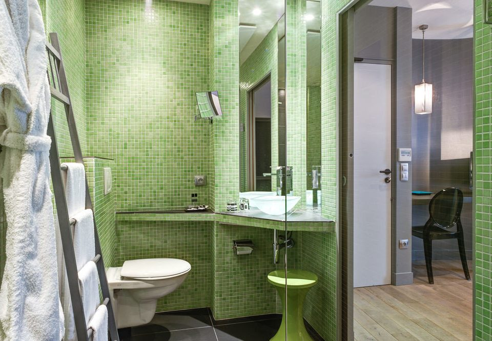 bathroom property green condominium public toilet toilet tiled