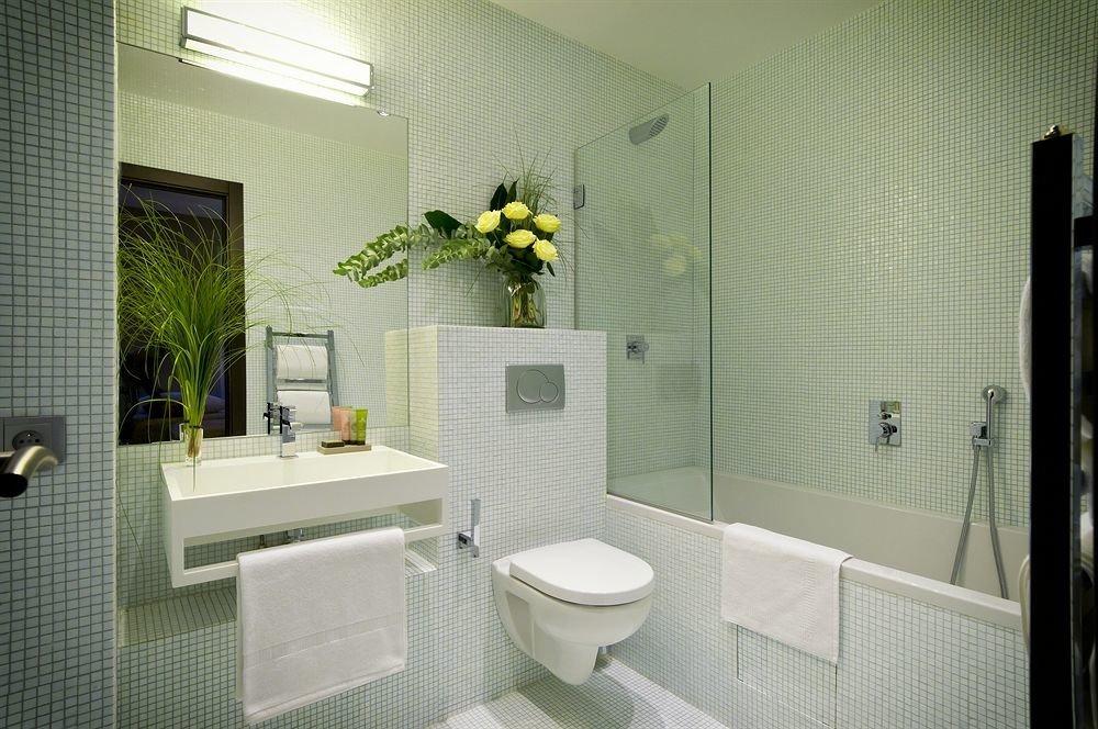 bathroom mirror property sink toilet home condominium tile tiled