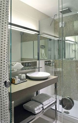 bathroom sink mirror property shower condominium plumbing fixture loft tiled