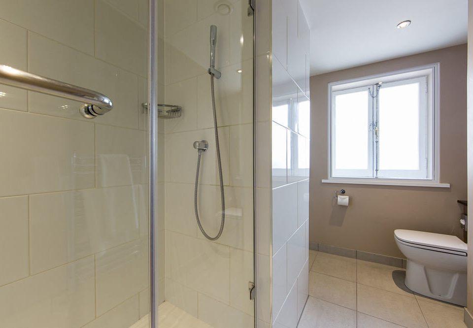 bathroom property scene white plumbing fixture home tiled tile containing tan