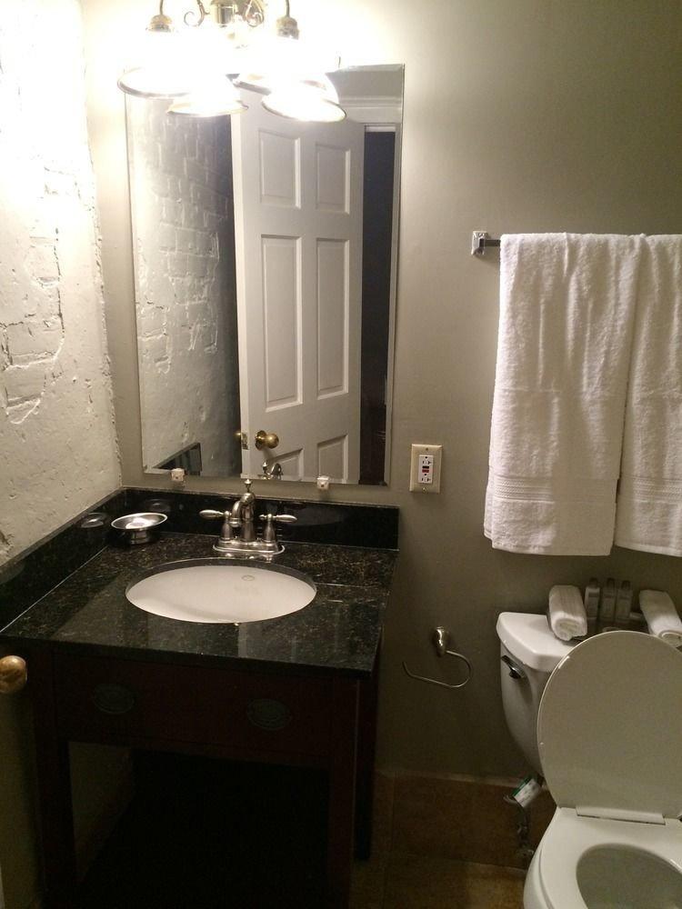 bathroom sink mirror property towel white home light toilet cottage countertop plumbing fixture rack
